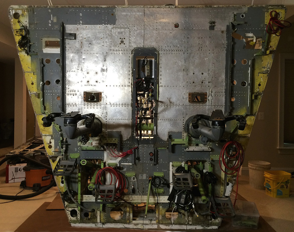 The floor section just prior to flipping back to horizontal. Various cable bundles are visible for connection to components above the floor. Kill switches for dynamic control loading motors are seen just inboard and forward of the FO control column.