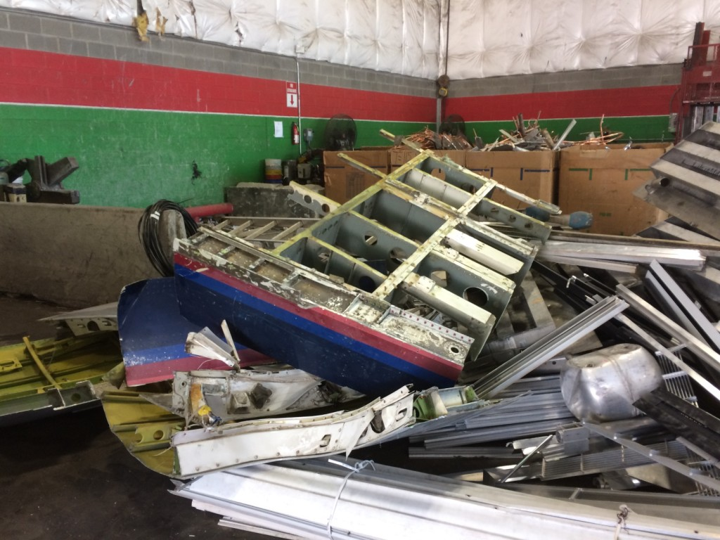 No longer needed for the project, the last 4 feet meets the scrap heap  some 27 years after it came off the assembly line. Destined to be turned into soda cans, this aircraft aluminum is worth about 40 cents a pound.