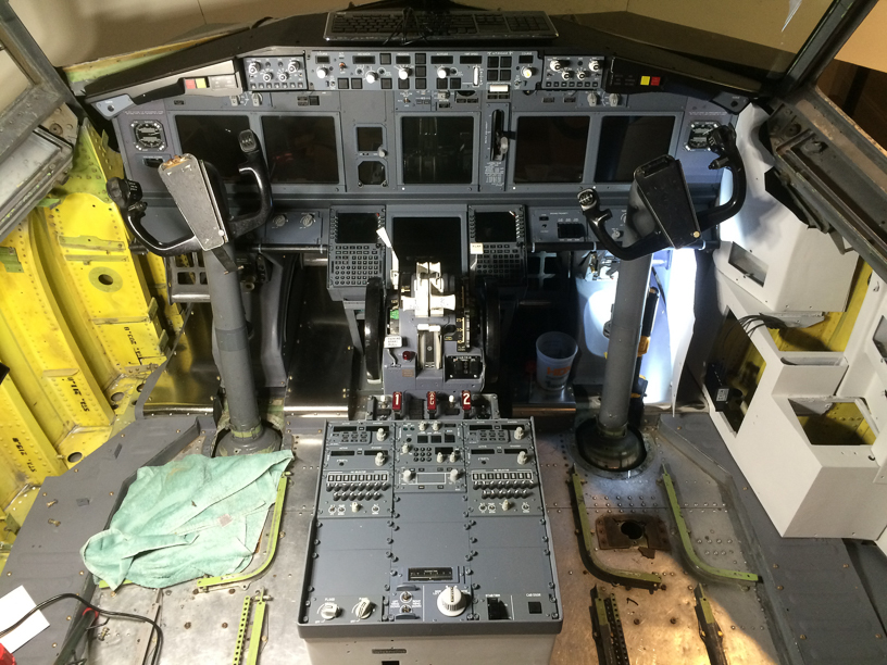 Just after completion of installation of Boeing OEM TQ and pedestal. TQ was heavily modified by Art May-Alyea at Northern Fligth Sim, with custom interfacing to provide functionality. Pedestal components by FDS, except the fire panel, which is Boeing OEM.